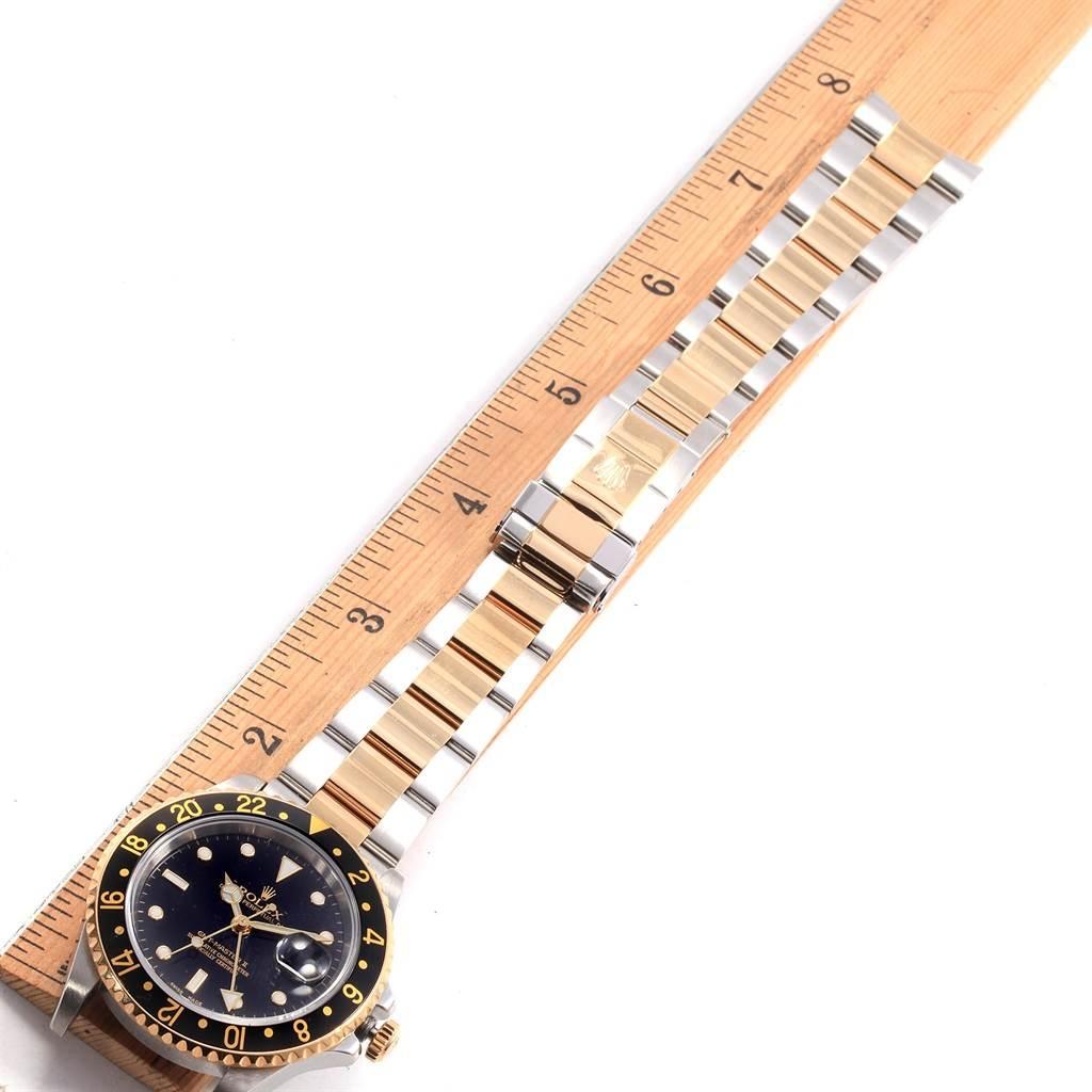 Rolex GMT Master II Yellow Gold Steel Black Dial Mens Watch 16713 SwissWatchExpo